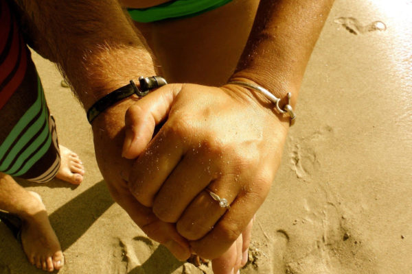 Couple with matching hook bracelets.